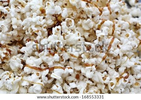 Close up of popcorn with caramel - stock photo