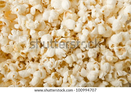 close up of popcorn with salt and pepper and lightly buttered and ready for a movie