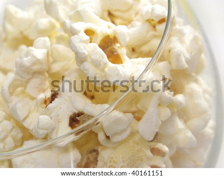Close up of popcorns in bowl made of glass