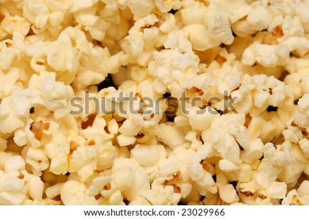 Close up of popped popcorn for background or texture. - stock photo