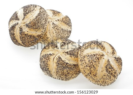 Close up of poppy seed bread rolls on a white background