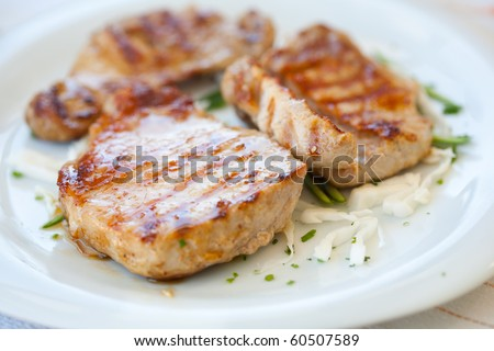 Close up of pork steak on a white plate - stock photo