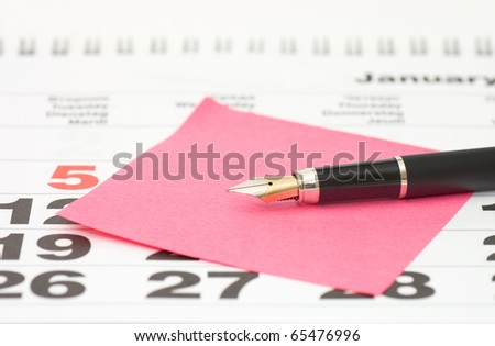 Close up of Post-It Note on Calendar - stock photo