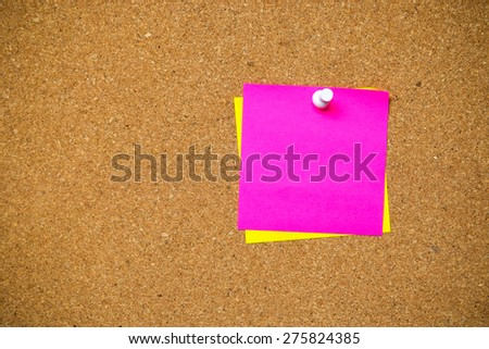 close up of post it note papers on a cork board - stock photo