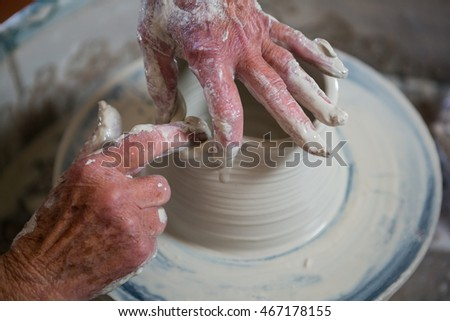 Close-up of potter making pot in pottery workshop