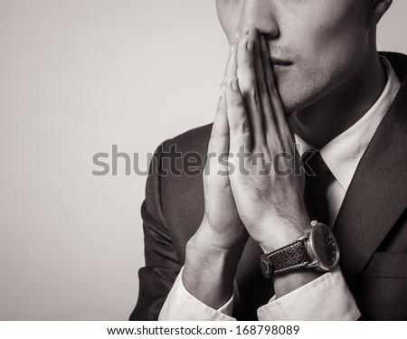 Close up of praying man - stock photo