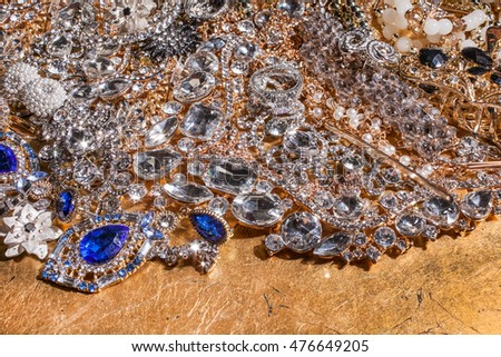 Close up of precious luxury jewelry on golden background