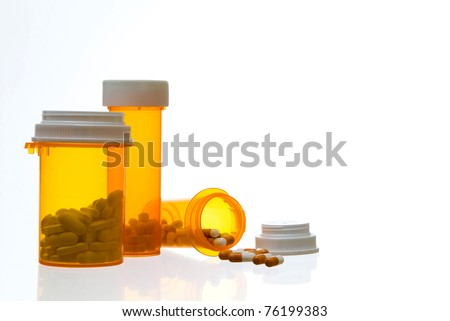Close up of Prescription Containers and Medication - stock photo