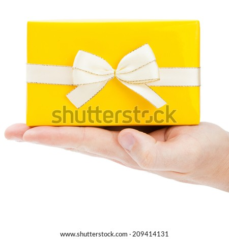 Close-up of present box on male palm - 1 to 1 ratio - stock photo
