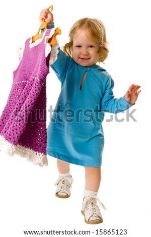 Close-up of pretty baby with new dress on hanger, isolated over white - stock photo