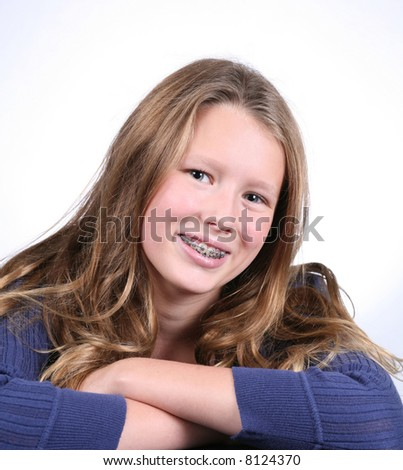 close up of pretty blond girl with braces smiling - stock photo