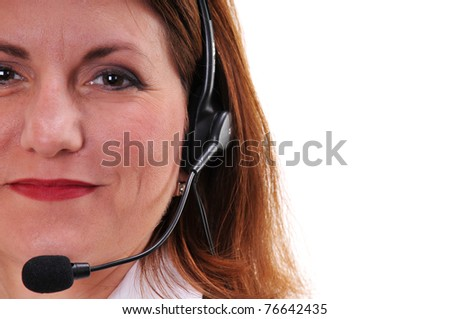 Close up of pretty business woman with headset - isolated over a white background - stock photo