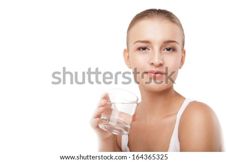 Close-up of pretty girl drinking water from glass isolated on white - stock photo