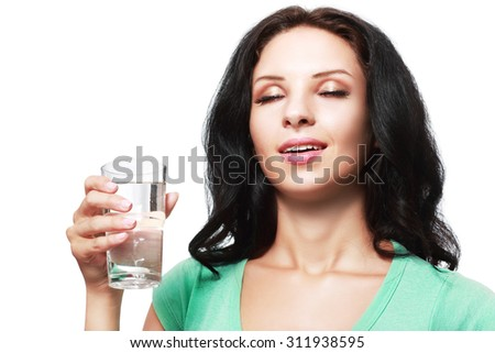 Close-up of pretty girl enjoying after drinking water from glass - stock photo