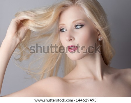Close Up of Pretty Teen With Makeup and Blowing Hair