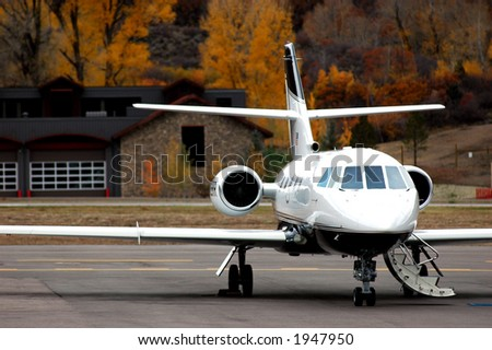 close up of private jet on tarmac ready for passenger boarding - stock photo
