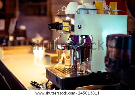 Close up of professional coffee machine making espresso in a cafe, Film look process - stock photo