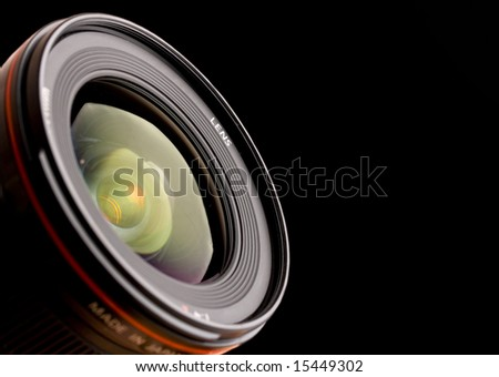close up of professional lens on black - stock photo