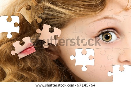 Close up of profile child puzzle pieces on white table. - stock photo