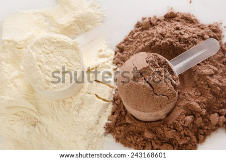Close up of protein powder and scoops - stock photo