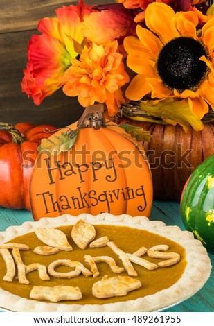 Close up of pumpkin pie on the table decorated for Thanksgiving party.