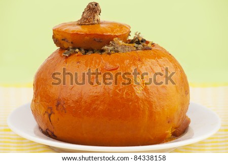 Close-up of pumpkin stuffed with rice, meat and vegetables - stock ...