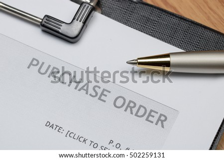 Close up of purchase order form with pen  / selective focus