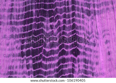 Close up of purple tie dye hippy dress - stock photo