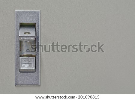 close-up of push switch for open on control box in on state ; selective focus on switch - stock photo