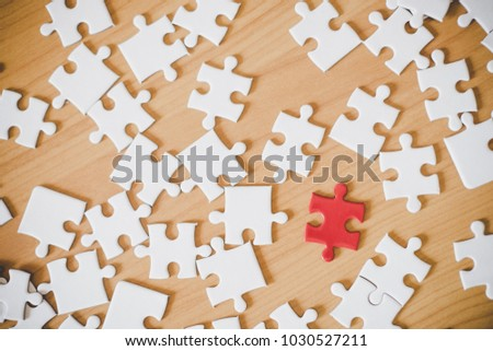 close up of puzzle pieces on table, business and connection concept