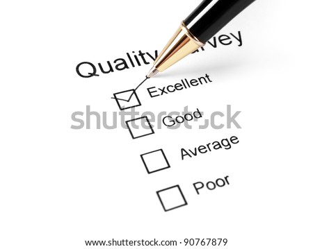 close up of quality survey questionnaire and pen
