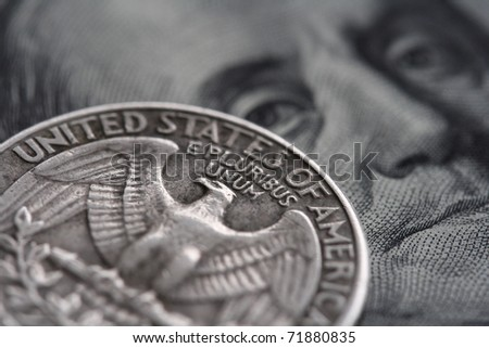 close-up of quarter dollar coin on the one hundred Dollar bill - stock photo