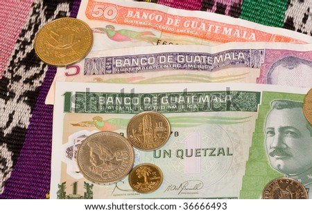Close up of Quetzales, the currency of the country of Guatemala. Coins on notes. - stock photo