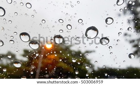 Close up of rain drops on car winshield
