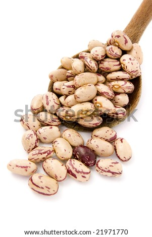 close up of raw beans and wooden spoon on white background with clipping path