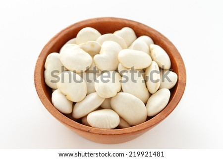 close up of raw haricot beans in wooden bowl - stock photo