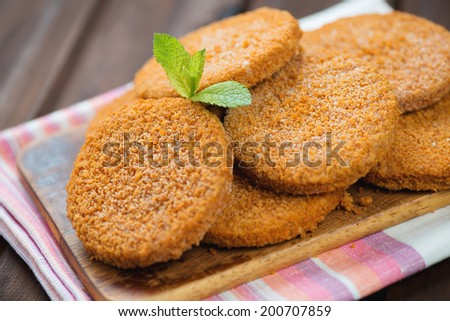 Close-up of raw salmon cutlets on a cutting board, studio shot - stock photo
