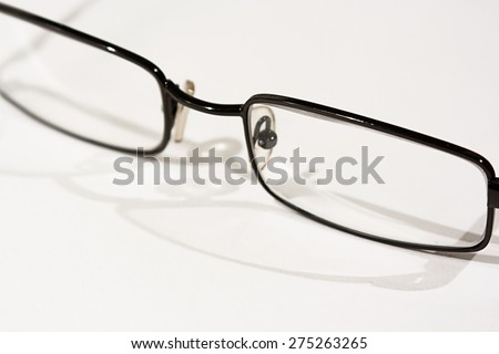Close up of reading glasses on a white background