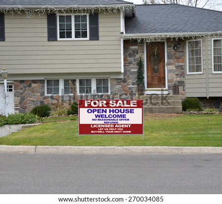 Close up of Real Estate for sale open house welcome sign high ranch style home residential neighborhood USA - stock photo