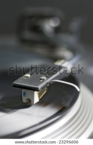 close-up of record player tone arm, pick-up cartridge and stylus; differential focus - stock photo