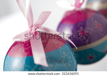 Close up of red and blue christmas baubels shot with shallow depth of field - stock photo
