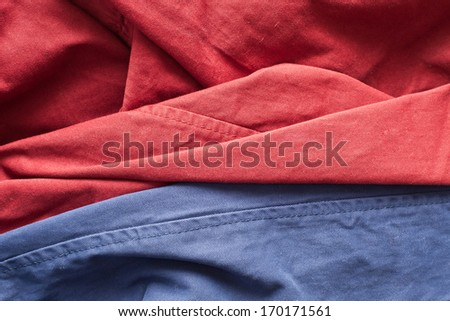 Close up of red and blue cotton trousers with seam lines - stock photo