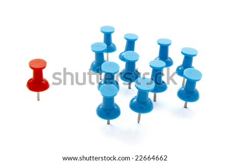 close up of red and blue push pins on white background with clipping path