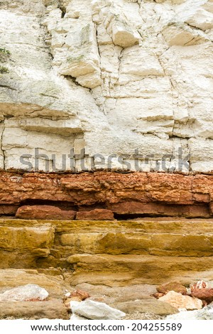 Close up of red and white sandstone and chalk cliffs at Hunstanton,Norfolk,England - stock photo
