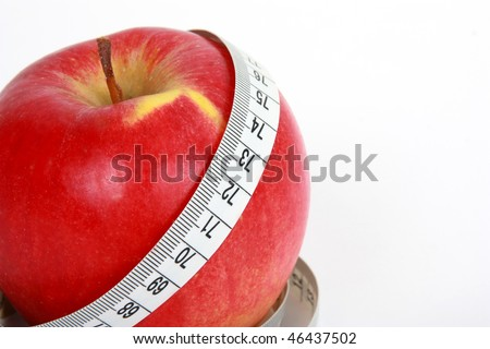 Close up of  red apple with tape-line. isolated on white - stock photo