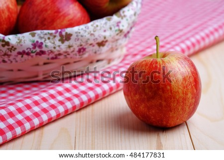 Close up of red apples with selective focus on wooden table, vintage and decorated.