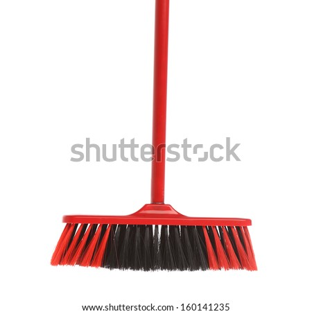 Close up of red black broom. Isolated on a white background. - stock photo