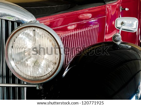 Close up of Red classic vintage car - stock photo