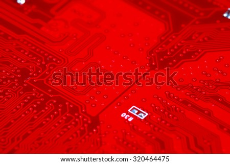 Close-up of red electronic motherboard circuit with processor - stock photo