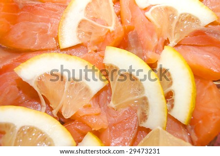 Close up of red fish with a lemon - stock photo